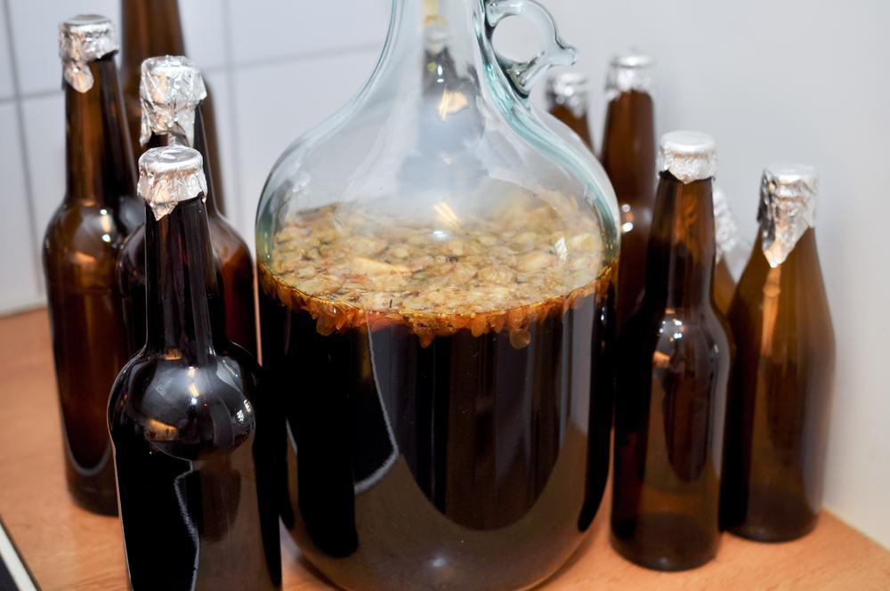1 gallon homebrew jug with yeast rafts