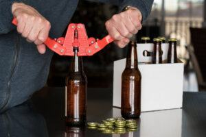 man capping bottles of homebrew with Perrysbrewer Bottle Capper